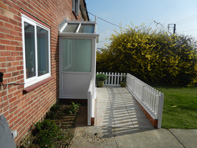 Wheelchair access ramp and picket fence installed recently adjacent to Porch