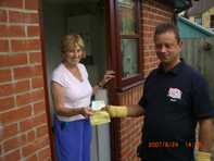 Paul our glazier accepting a cheque from another happy customer