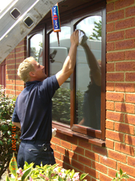 Our glazier cleaning sealed units after installation