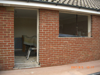 Before - We removed existing door, window and brickwork