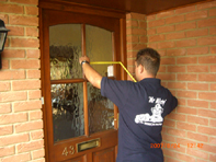 Paul our Glazier measuring a front door for glass